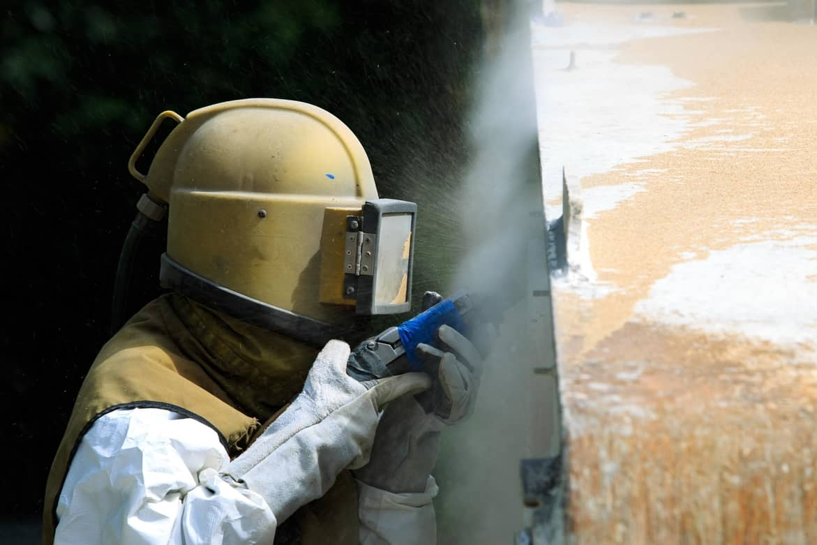 Sandblasting in worcester, professional blaster wearing equipment